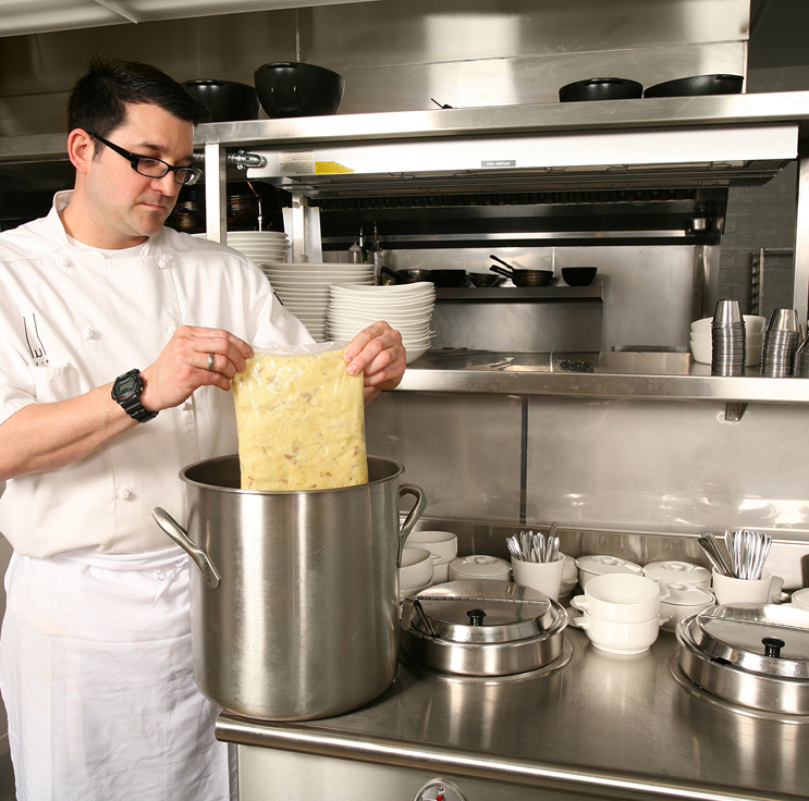 restaurant chef rethermalizing soup stored and then heated in a cook chill bag from Plascon